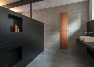 Radiateur de salle de bains orange et brun avec Jeanfils à Liège